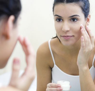 a-generic-photo-of-a-woman-applying-face-cream