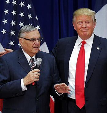 U.S. Republican presidential candidate Donald Trump is joined onstage by Maricopa County Sheriff Joe Arpaio (L) at a campaign rally in Marshalltown, Iowa January 26, 2016, after Arpaio endorsed Trump's. REUTERS/Brian Snyder - RTX245CC